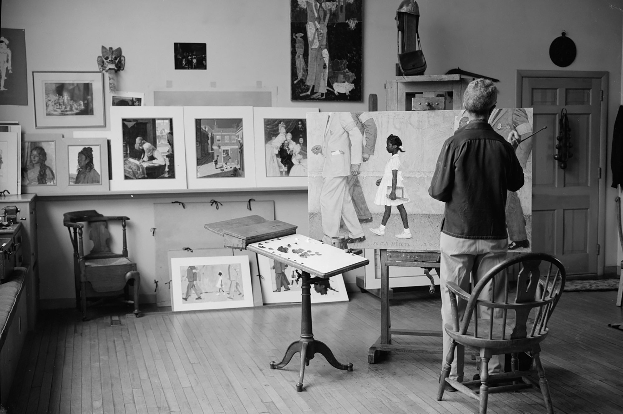 Norman Rockwell in his studio painting The Problem We All Live With