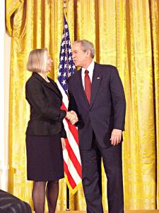 Laurie Norton Moffatt, Director/CEO, receiving the 2008 National Humanities Medal from President George W. Bush at the White House.