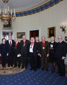 President George W. Bush and Mrs. Laura Bush stand with the recipients of the 2008 National Humanities Medal in the Blue Room at the White House. Norman Rockwell Museum Director and CEO Laurie Norton Moffatt is pictured on the far right.