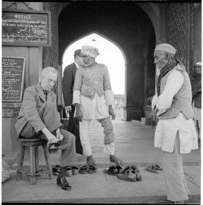 Norman Rockwell entering a mosque, Delhi, India, 1962. Photo by Molly Rockwell. From the permanent collection of Norman Rockwell Museum.