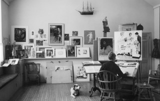 "Photo of Norman Rockwell working on ""First Trip to the Beauty Parlor"" with dog Pitter in his Stockbridge studio, 1972. Photo by Bill Scovill. Norman Rockwell Museum Collections. ©NRELC: Niles, IL."