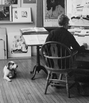 "Reference photo of Norman Rockwell working on ""First Trip to the Beauty Parlor"" with dog Pitter in his Stockbridge studio, 1972. Photo by Bill Scovill. Norman Rockwell Museum Collections. ©NRELC: Niles, IL"