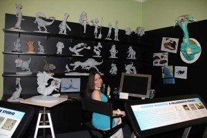 "Blue Sky Studios animator Alena Wooten hangs out in a simulation of her workspace, as seen in the exhibition ""'Ice Age' to the Digital Age."" Photo ©Norman Rockwell Museum. All rights reserved."