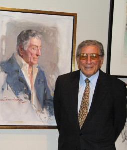 Singer Tony Bennett with his portrait, created by artist Everett Raymond Kinstler. ©Norman Rockwell Museum. All rights reserved.