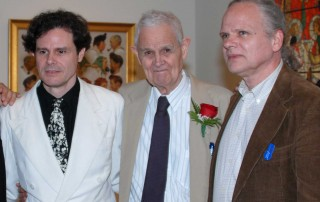 """Illustration historian/author Walt Reed with his sons Roger Reed (left) and Jeffrey Reed (right), receives the Distinguished Scholar Award during the opening of """"Howard Pyle: American Master Rediscovered,"""" June 9, 2012 at Norman Rockwell Museum. Photo ©Norman Rockwell Museum. All rights reserved."""