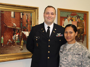 "First Lieutenant Andrew Shaw and Sergeant Kelsey Shaw, view Rockwell's ""Homecoming"" paintings, at the Museum's ""Here at Home Homecoming"" event in June 2012."