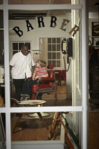 "Photo of actors Danny Glover and Dash Pledger-Levine in a scene from the Hallmark Movie Channel's original movie, ""Norman Rockwell's Shuffleton's Barbershop."" Courtesy and ©Crown Media, all rights reserved."