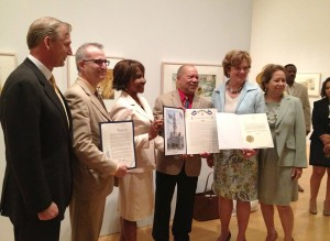 "Artist Jerry Pinkney (center) was presented with a special commendation by Pennsylvania's First Lady, Susan Corbett (right) at The Philadelphia Museum of Art on June 26, 2013 (""Jerry Pinkney Day""). Philadelphia Museum Director and CEO, Timothy Rub (far left) joined the artist for the opening of ""Witness: The Art of Jerry Pinkney,"" on view through September 22, 2013. Photo by Stephanie Plunkett for Norman Rockwell Museum. ©Norman Rockwell Museum. All rights reserved."