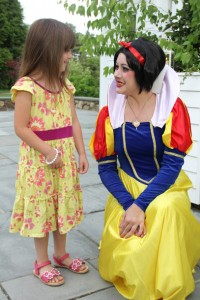 "Snow White meets a fan at the opening of ""Snow White and the Seven Dwarfs: The Creation of a Classic"" at Norman Rockwell Museum, June 8, 2013. Photo by Jeremy Clowe for Norman Rockwell Museum. © and all rights reserved."