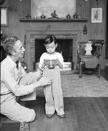Norman Rockwell Helps a Young Model Pose in His Arlington, VT studio, 1953