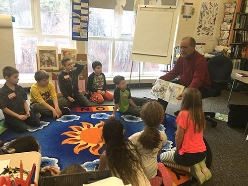 Illustrator Jerry Pinkney teaching students in Muddy Brook Regional Elementary School as part of Norman Rockwell Museum's Berkshire County Student Passport Program.